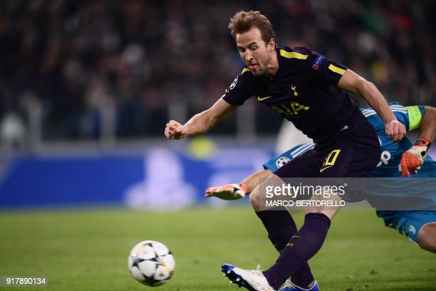 Tottenham Hotspur's English striker Harry Kane shoots to score his team's first goal during the UEFA Champions League round of sixteen first leg...