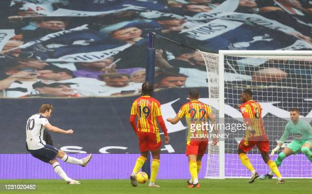 Tottenham Hotspur's English striker Harry Kane shoots to score the opening goal of the English Premier League football match between Tottenham...
