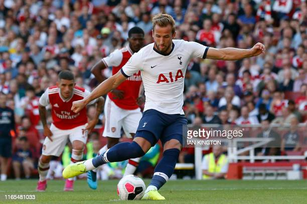 Tottenham Hotspur's English striker Harry Kane shoots to score their second goal from the penalty spot during the English Premier League football...