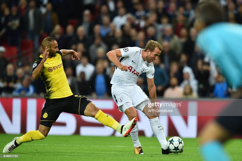 Tottenham Hotspur's English striker Harry Kane (R) shoots to score their second goal during the UEFA Champions League Group H football match between Tottenham Hotspur and Borussia Dortmund at Wembley Stadium in London, on September 13, 2017. / AFP PHOTO / Glyn KIRK