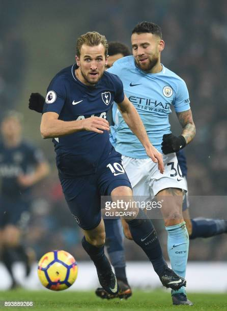 Tottenham Hotspur's English striker Harry Kane spins past Manchester City's Argentinian defender Nicolas Otamendi during the English Premier League...
