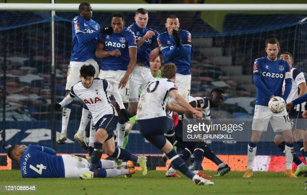 Tottenham Hotspur's English striker Harry Kane takes a free kick during the English FA Cup fifth round football match between Everton and Tottenham...