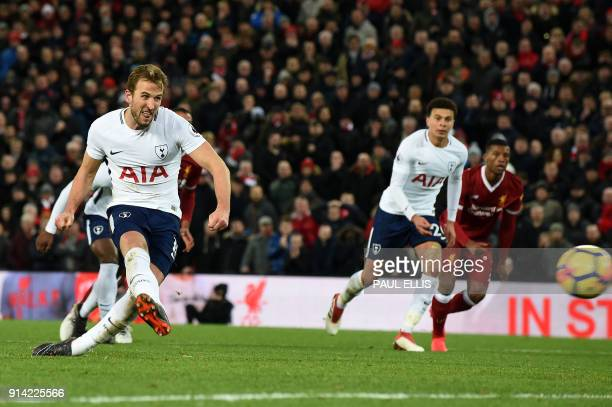 Tottenham Hotspur's English striker Harry Kane takes a penalty and scores his team's second goal during the English Premier League football match...