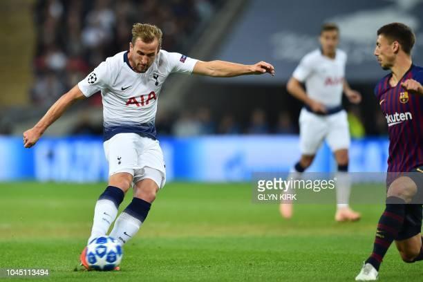 Tottenham Hotspur's English striker Harry Kane takes an unsuccessful shot during the Champions League group B football match match between Tottenham...
