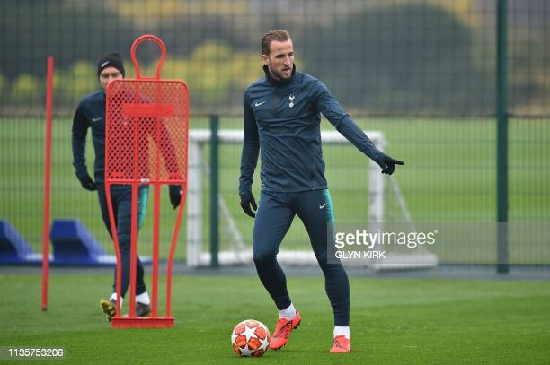 Tottenham Hotspur's English striker Harry Kane takes part in a training session on the eve of their UEFA Champions league quarter final football...