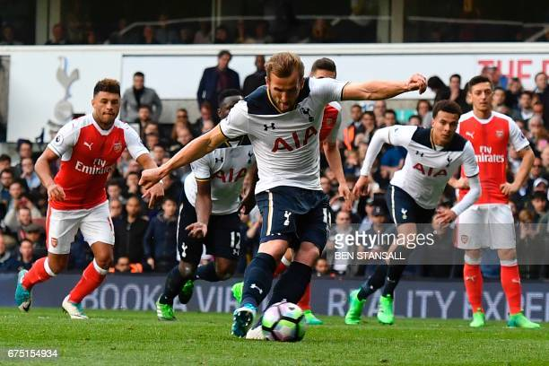 Tottenham Hotspur's English striker Harry Kane takes the penalty to score the team's second goal during the English Premier League football match...