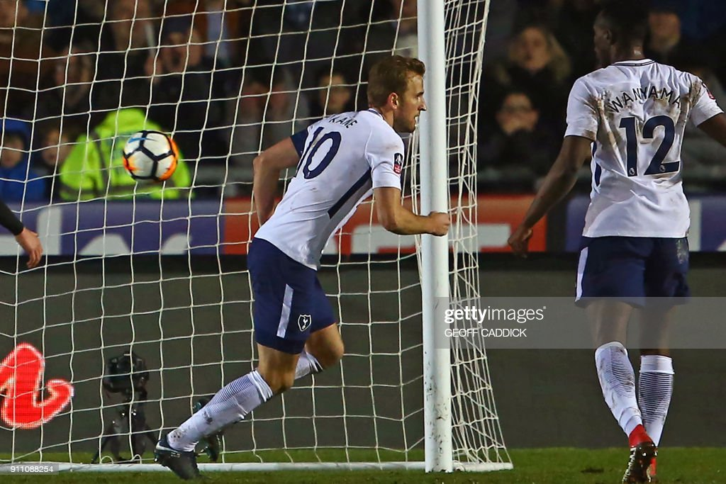 Tottenham Hotspur's English striker Harry Kane (C) turns to celebrate after scoring their first goal during the English FA Cup fourth round football match between Newport County and Tottenham Hotspur at Rodney Parade in Newport, in south Wales, on January 27, 2018. / AFP PHOTO / Geoff CADDICK / RESTRICTED TO EDITORIAL USE. No use with unauthorized audio, video, data, fixture lists, club/league logos or 'live' services. Online in-match use limited to 75 images, no video emulation. No use in betting, games or single club/league/player publications. /