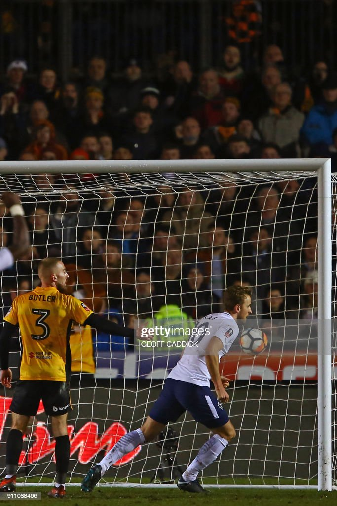 Tottenham Hotspur's English striker Harry Kane (R) turns to celebrate after scoring their first goal during the English FA Cup fourth round football match between Newport County and Tottenham Hotspur at Rodney Parade in Newport, in south Wales, on January 27, 2018. / AFP PHOTO / Geoff CADDICK / RESTRICTED TO EDITORIAL USE. No use with unauthorized audio, video, data, fixture lists, club/league logos or 'live' services. Online in-match use limited to 75 images, no video emulation. No use in betting, games or single club/league/player publications. /