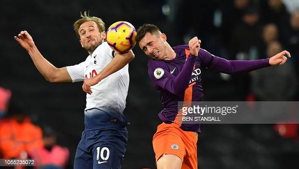 Tottenham Hotspur's English striker Harry Kane vies in the air to head the ball against Manchester City's French defender Aymeric Laporte during the...