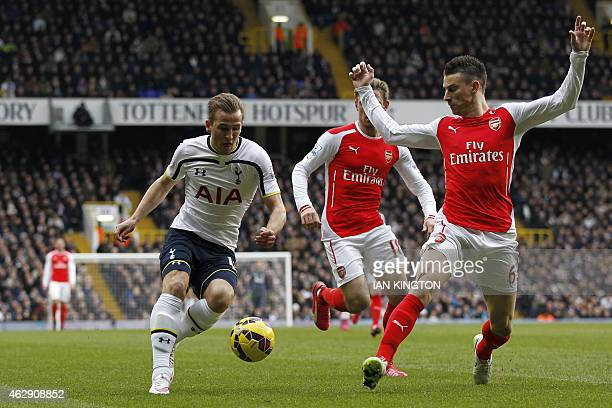 Tottenham Hotspur's English striker Harry Kane vies with Arsenal's French defender Laurent Koscielny during the English Premier League football match...