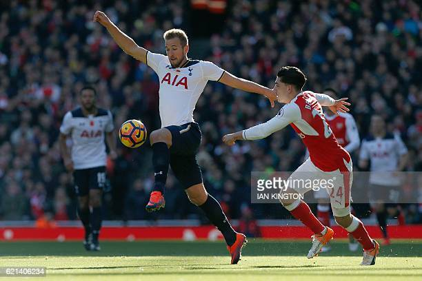 TOPSHOT Tottenham Hotspur's English striker Harry Kane vies with Arsenal's Spanish defender Hector Bellerin during the English Premier League...