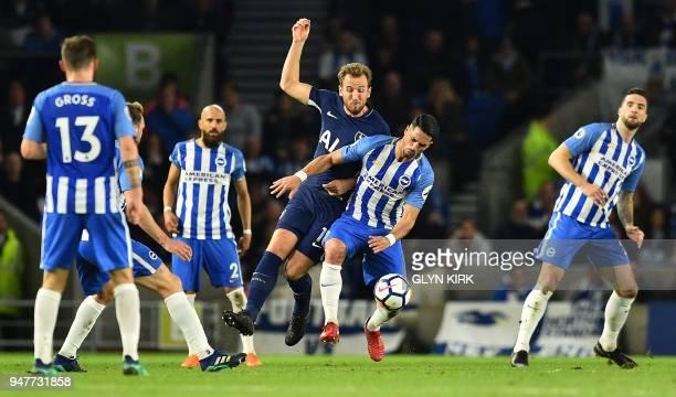 Tottenham Hotspur's English striker Harry Kane vies with Brighton's Israeli midfielder Beram Kayal during the English Premier League football match...