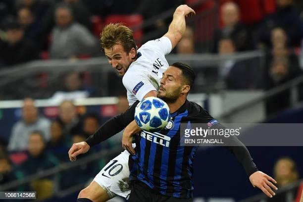 Tottenham Hotspur's English striker Harry Kane vies with Inter Milan's Italian defender Danilo D'Ambrosio during the UEFA Champions League group B...