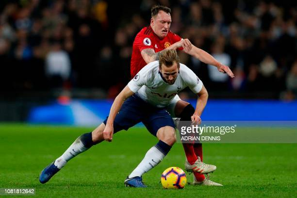 Tottenham Hotspur's English striker Harry Kane vies with Manchester United's English defender Phil Jones during the English Premier League football...