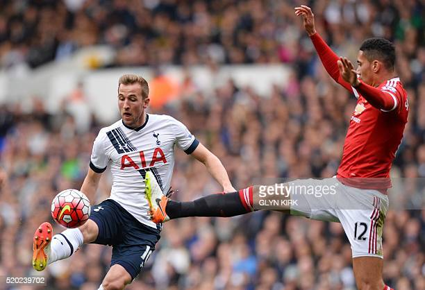 Tottenham Hotspur's English striker Harry Kane vies with Manchester United's English defender Chris Smalling during the English Premier League...