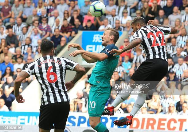 Tottenham Hotspur's English striker Harry Kane vies with Newcastle United's English defender Jamaal Lascelles and Newcastle United's US defender...