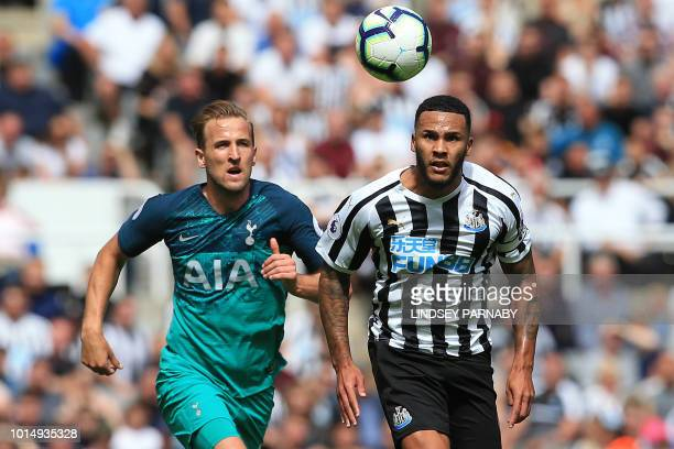 Tottenham Hotspur's English striker Harry Kane vies with Newcastle United's English defender Jamaal Lascelles during the English Premier League...