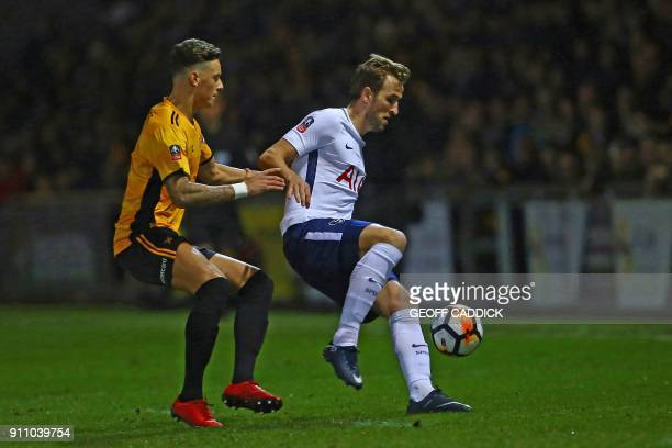 Tottenham Hotspur's English striker Harry Kane vies with Newport County's English defender Ben White during the English FA Cup fourth round football...