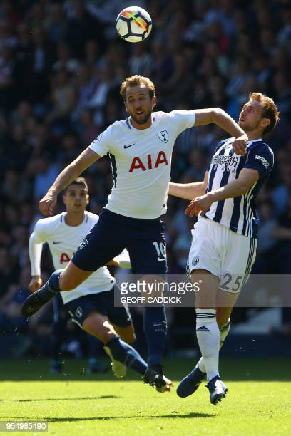 Tottenham Hotspur's English striker Harry Kane vies with West Bromwich Albion's English defender Craig Dawson to head the ball during the English...