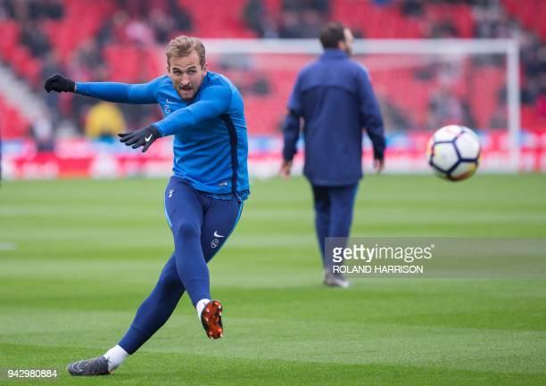 Tottenham Hotspur's English striker Harry Kane warms up ahead of the English Premier League football match between Stoke City and Tottenham Hotspur...