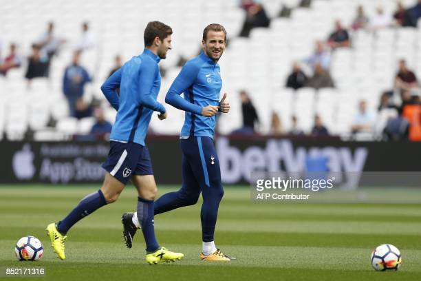 Tottenham Hotspur's English striker Harry Kane warms up before the English Premier League football match between West Ham United and Tottenham...