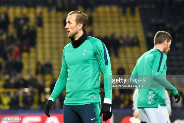 Tottenham Hotspur's English striker Harry Kane warms up prior to the UEFA Champions League round of 16 second leg football match between BVB Borussia...