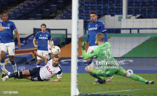 Tottenham Hotspur's English striker Harry Kane watches as his attempt on goal is saved during the English FA Cup fifth round football match between...