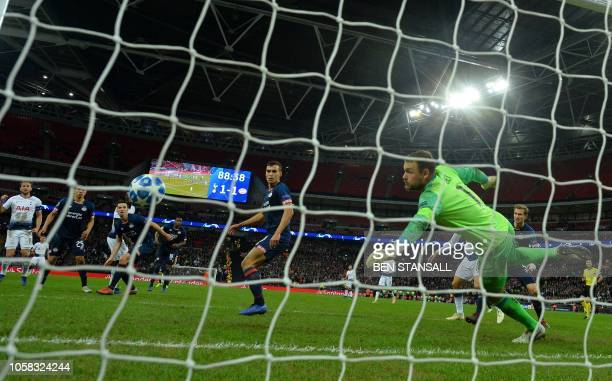 Tottenham Hotspur's English striker Harry Kane watches the ball in to the net after scoring his team's second goal during the UEFA Champions League...