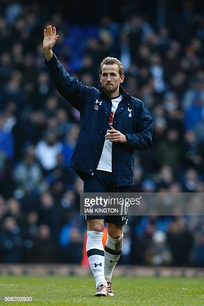 Tottenham Hotspur's English striker Harry Kane waves to the crowd at the end of the English Premier League football match between Tottenham Hotspur...
