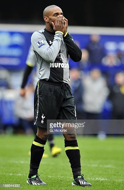 Tottenham Hotspur's English striker Jermain Defoe reacts after a missed chance at goal during the English Premier League match between QPR and...