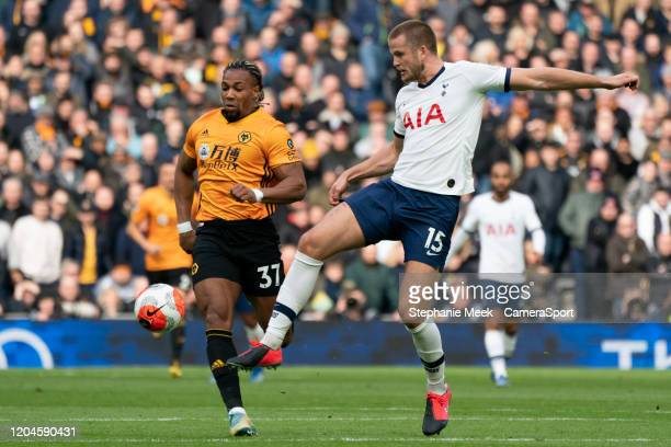Tottenham Hotspur's Eric Dier passes the ball despite the attentions of Wolverhampton Wanderers' Adama Traore during the Premier League match between...