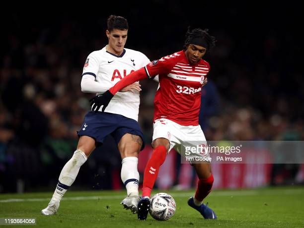 Tottenham Hotspur's Erik Lamela and Middlesbrough's Djed Spence battle for the ball during the FA Cup third round replay match at Tottenham Hotspur...