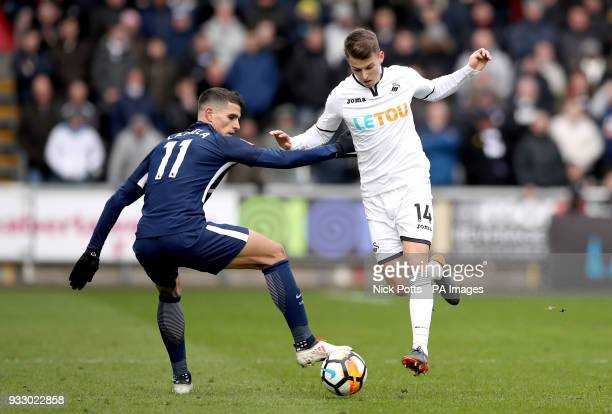 Tottenham Hotspur's Erik Lamela and Swansea City's Tom Carroll battle for the ball during the Emirates FA Cup quarter final match at the Liberty...