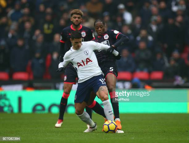 Tottenham Hotspur's Erik Lamela tussle with Huddersfield Town's Terence Kongolo during the Premiership League match between Tottenham Hotspur and...