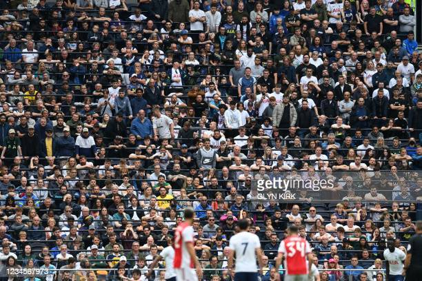 Tottenham Hotspur's fans look on from the newly installed rail seating during the pre-season friendly football match between Tottenham Hotspur and...