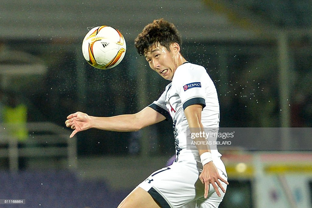 Tottenham Hotspurs forward from South Korea Heng-Min Son jumps for the ball during the UEFA Europa League football match Fiorentina vs Tottenham on February 18, 2016 at Florence's 'Artemio Franchi' comunal stadium.