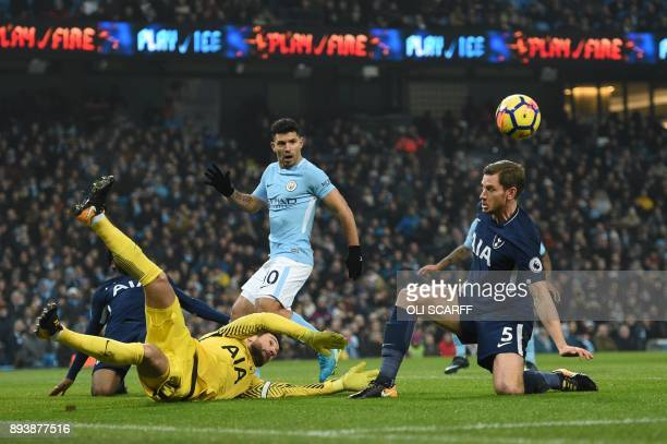 Tottenham Hotspur's French goalkeeper Hugo Lloris and Tottenham Hotspur's Belgian defender Jan Vertonghen block an opportunity for Manchester City's...