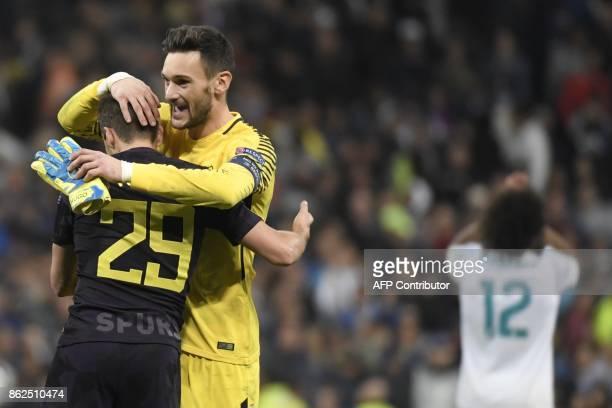 Tottenham Hotspur's French goalkeeper Hugo Lloris and Tottenham Hotspur's English midfielder Harry Winks celebrate after the UEFA Champions League...