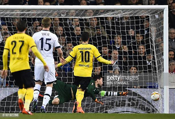 Tottenham Hotspur's French goalkeeper Hugo Lloris dives but cannot prevent the shot from Borussia Dortmund's Gabonese striker PierreEmerick...