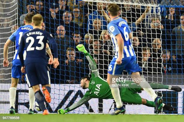 Tottenham Hotspur's French goalkeeper Hugo Lloris dives but fails to save a penalty strike from Brighton's German midfielder Pascal Gross during the...
