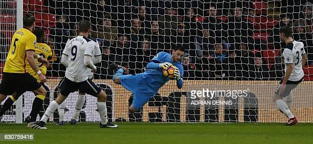 Tottenham Hotspur's French goalkeeper Hugo Lloris dives to make a save during the English Premier League football match between Watford and Tottenham...