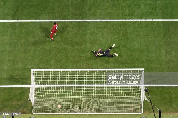 Tottenham Hotspur's French goalkeeper Hugo Lloris fails to catch a ball kicked by Liverpool's Belgium striker Divock Origi during the UEFA Champions...