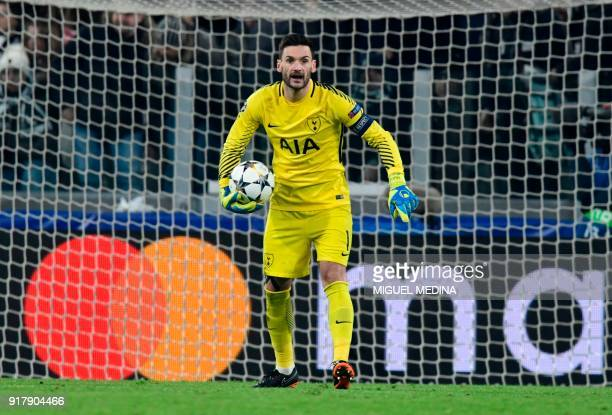 Tottenham Hotspur's French goalkeeper Hugo Lloris holds the ball during the UEFA Champions League round of sixteen first leg football match between...