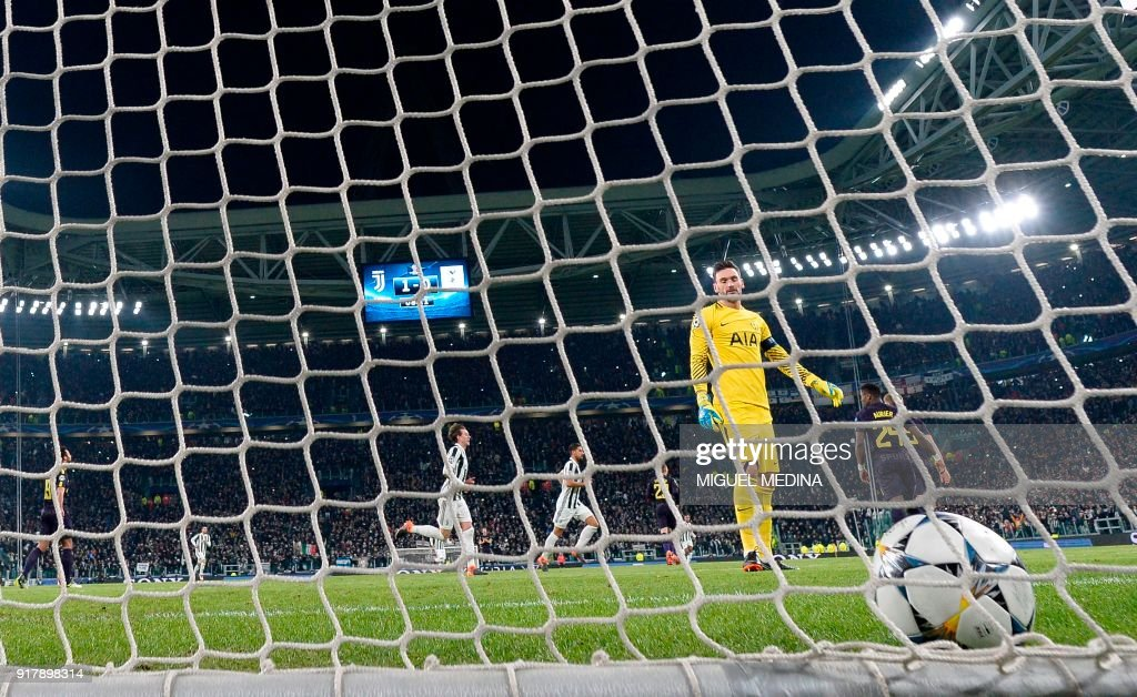 Tottenham Hotspur's French goalkeeper Hugo Lloris looks towards his net after conceding a penalty goal during the UEFA Champions League round of sixteen first leg football match between Juventus and Tottenham Hotspur at The Allianz Stadium in Turin on February 13, 2018. /