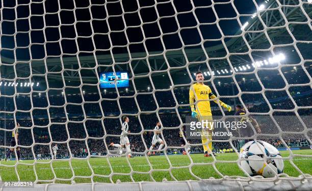 Tottenham Hotspur's French goalkeeper Hugo Lloris looks towards his net after conceding a penalty goal during the UEFA Champions League round of...