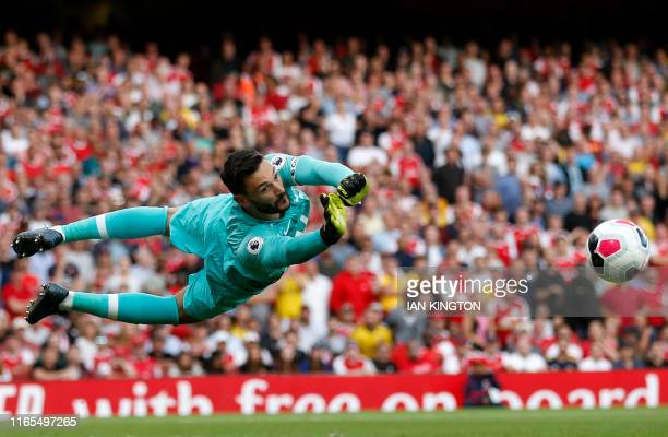 Tottenham Hotspur's French goalkeeper Hugo Lloris makes a save during the English Premier League football match between Arsenal and Tottenham Hotspur...