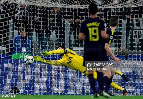 Tottenham Hotspur's French goalkeeper Hugo Lloris makes a save during the UEFA Champions League round of sixteen first leg football match between...