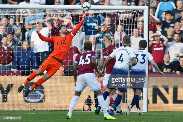 Tottenham Hotspur's French goalkeeper Hugo Lloris makes a save from a header by West Ham United's Austrian striker Marko Arnautovic during the...