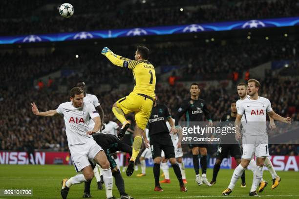 TOPSHOT Tottenham Hotspur's French goalkeeper Hugo Lloris punches the ball away during the UEFA Champions League Group H football match between...