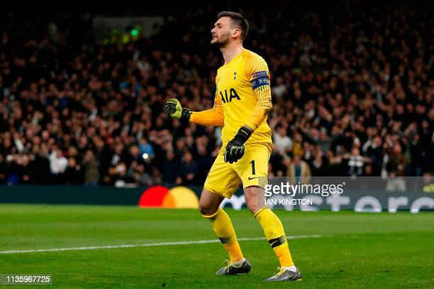 Tottenham Hotspur's French goalkeeper Hugo Lloris reacts after saving a penalty shot from Manchester City's Argentinian striker Sergio Aguero during...